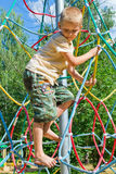 The boy climbs the ropes Stock Photo