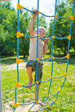 The boy climbs the ropes Royalty Free Stock Photo