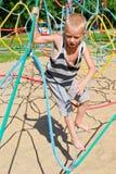 The boy climbs the ropes Stock Photos