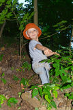 The boy climbs the slope of the ravine Royalty Free Stock Photo