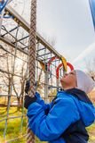 The boy climbs up a rope stock photography