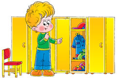 Boy in cloakroom Stock Photos