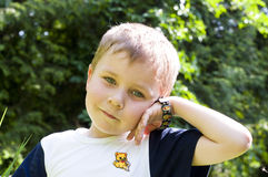 Boy with clock. On a background of nature Stock Photos