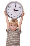 Boy with a clock Stock Photos
