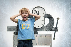 Boy with clock Stock Image