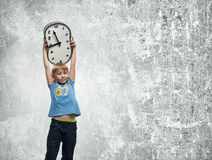Boy with clock Stock Photography