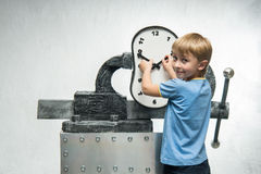 Boy with clock Royalty Free Stock Photo