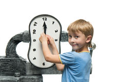 Boy with clock Stock Images