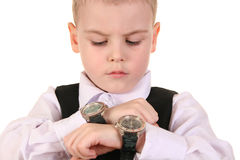 Boy with clocks. Boy with two clocks on white Stock Photography