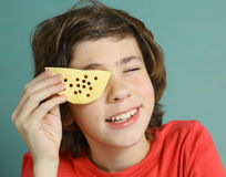 Boy close up photo with piece of cheese stock image