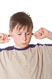 Boy with closed ears Stock Images