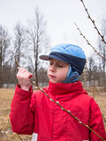 Boy with closed eyes holding a branch Stock Photo