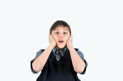 The boy closed his ears with his hands Royalty Free Stock Photography