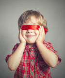 Boy closed his eyes the ribbon Royalty Free Stock Photo