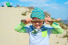 Boy closed his eyes with a stick Royalty Free Stock Image
