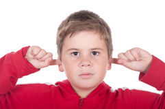 Boy closes ears fingers. On a white background Royalty Free Stock Images