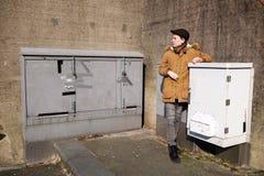 Boy at closets. Young boy standing at closets royalty free stock image