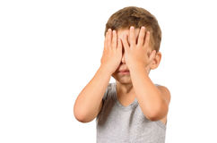 Boy closing eyes with hands Royalty Free Stock Photography