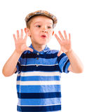 Boy and cloth cap Stock Photos