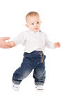 Boy in clothes makes first steps Royalty Free Stock Images