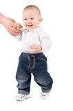Boy in clothes makes first steps Royalty Free Stock Photos