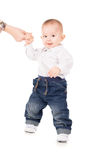 Boy in clothes makes first steps Stock Images