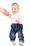Boy in clothes makes first steps Stock Photos