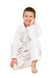 Boy in clothing for martial arts Stock Images