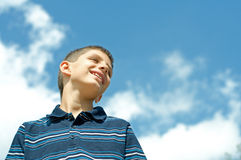 Boy at the clouds Stock Photos
