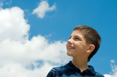 Boy at the clouds Royalty Free Stock Image