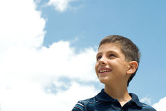 Boy at the clouds Stock Photo