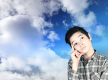 Boy in the clouds. CHILD TO DREAM IN THE CLOUDS Royalty Free Stock Photos