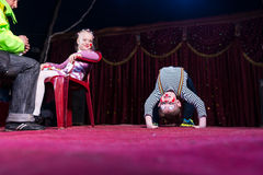 Boy Clown Doing Back Bend on Stage Royalty Free Stock Photos