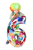 Boy in clown dress with balloon shape six isolated. On white background Royalty Free Stock Photo