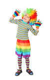 Boy in clown dress hands up isolated on white Royalty Free Stock Images