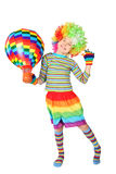 Boy in clown dress with multicolored balloon Stock Photos