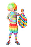 Boy in clown dress with multicolored baloon. Isolated on white background Royalty Free Stock Photo