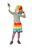Boy in clown dress pointing at side isolated Stock Photography