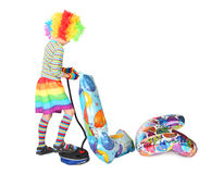 Boy in clown dress pupming birthday balloons royalty free stock photos