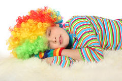 Boy in clown dress sleeping isolated Royalty Free Stock Photos
