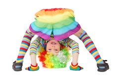 Boy in clown dress somersault isolated. Little boy in clown dress somersault isolated on white Stock Image