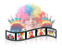 Boy in clown dress somersault isolated Royalty Free Stock Photography