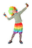 Boy in clown dress standing isolated on white Stock Photo