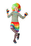 Boy in clown dress standing on one leg isolated Stock Photos