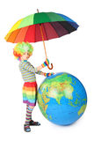 Boy in clown dress with umbrella and big globe Royalty Free Stock Image