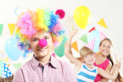 Boy clown and girls Stock Photo