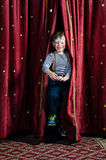 Boy Clown Jumping Through Stage Curtains Stock Image