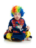 Boy clown with kitten inside hat Stock Image