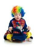 Boy clown with kitten inside hat Stock Image