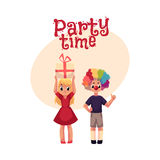 Boy with clown nose and wig, girl holding birthday gift Stock Image
